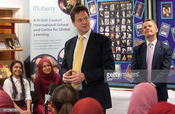British Deputy Prime Minister Nick Clegg addresses students as newly appointed British Education Minister David Laws looks on during an official...