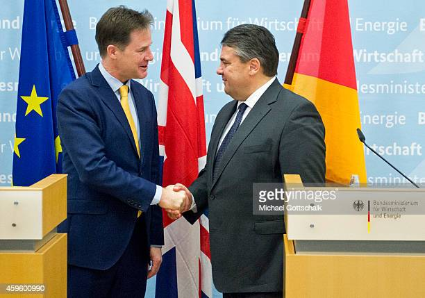 British Deputy Prime Minister Nick Clegg and German Economy Minister and Vice Chancellor Sigmar Gabriel shake hands as they attend a press statement...