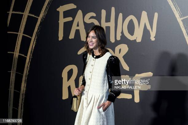 British designer Alexa Chung poses on arrival for the Fashion For Relief charity gala event on the second day of London Fashion Week in London on...