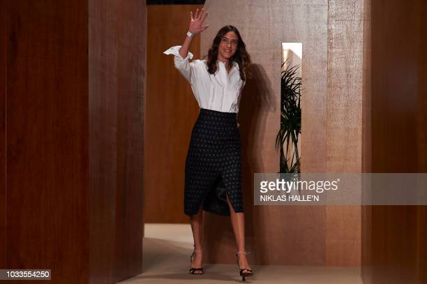 British designer Alexa Chung receives applause after her catwalk show for the Spring/Summer 2019 collection on the second day of London Fashion Week...