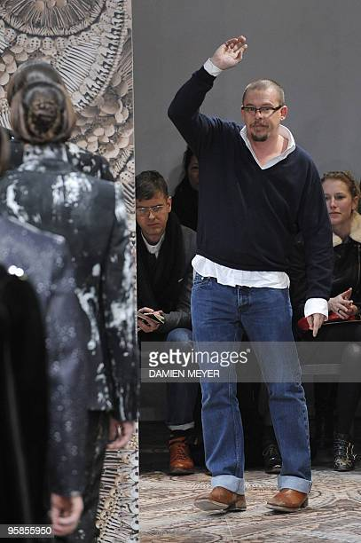 British designer Alexander McQueen acknowledges the audience after his FallWinter 20102011 Menswear collection on January 18 2010 during the Men's...