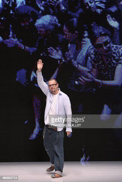 British designer Alexander McQueen waves at the end of his readytowear SpringSummer 2010 fashion show on October 6 2009 in Paris AFP PHOTO FRANCOIS...