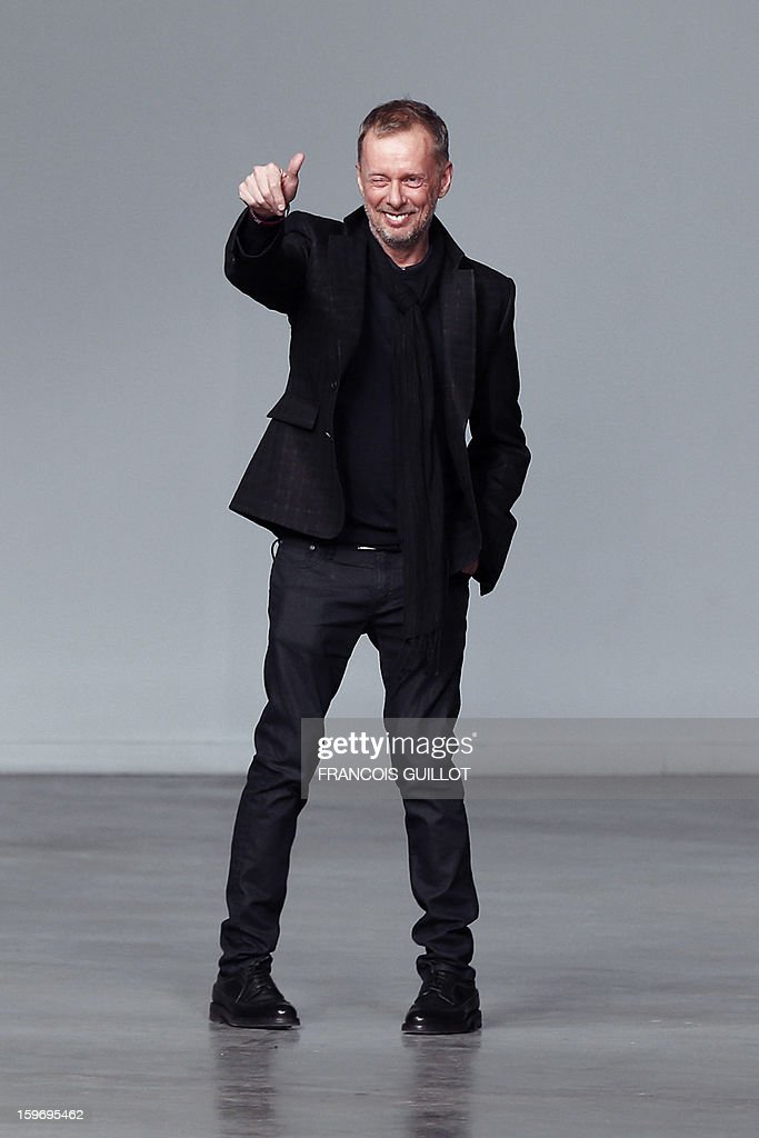 British designer Bill Gaytten acknowledges the audience at the end of John Galliano men's Fall-Winter 2013-2014 collection show on January 17, 2013 as part of the Men's fashion week in Paris.