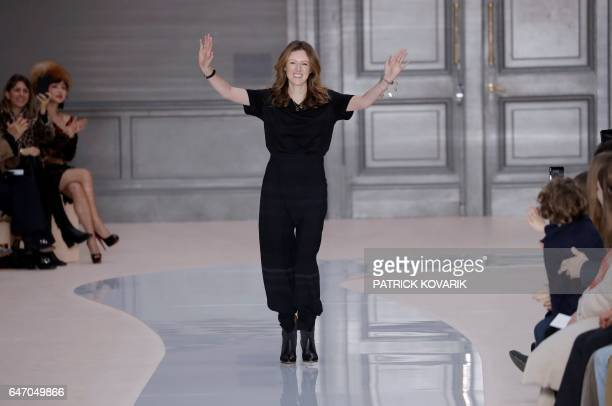 British designer Clare Waight Keller acknowledges the audience after the presentation of creations by Chloe during the women's FallWinter 20172018...