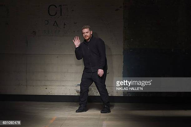 British designer Craig Green greets the crowd after his show on the first day of the Autumn/Winter 2017 London Fashion Week Men's fashion event in...