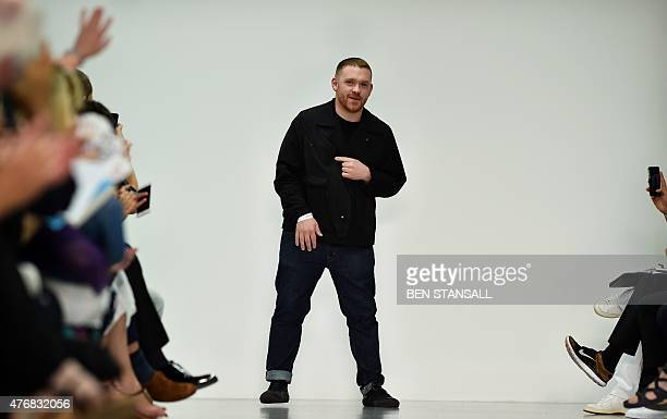 British designer Craig Green is seen following his fashion show on the opening day of the Spring/Summer 2016 London Collections Men fashion event in...