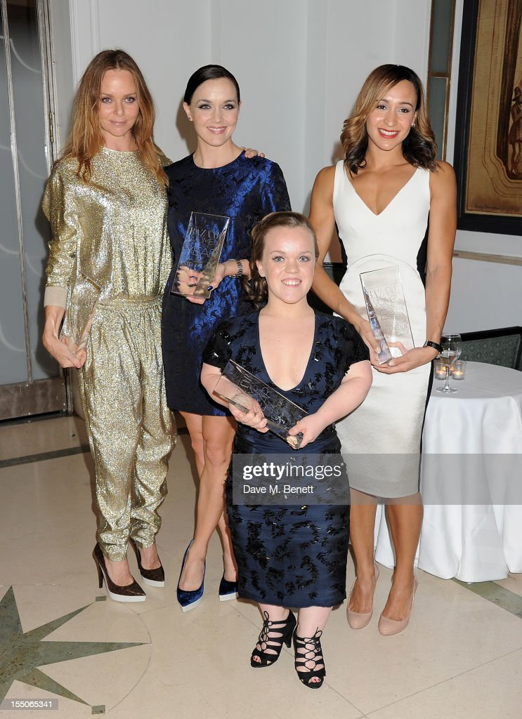British Designer of the Year winner Stella McCartney, and British Ambassadors of the Year co-winners Victoria Pendleton, Ellie Simmonds and Jessica Ennis pose at the Harper's Bazaar Women of the Year Awards 2012, in association with Estee Lauder, Harrods and Tiffany & Co., at Claridge's Hotel on October 31, 2012 in London, England.