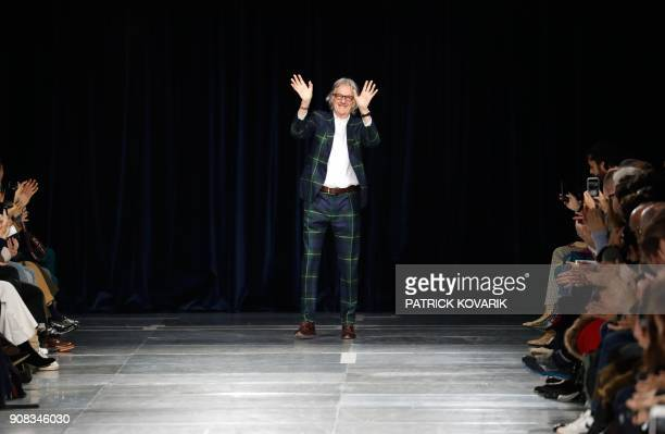 British designer Paul Smith acknowledges the audience during men's Fashion Week for the Fall/Winter 2018/2019 collection in Paris on January 21 2018...