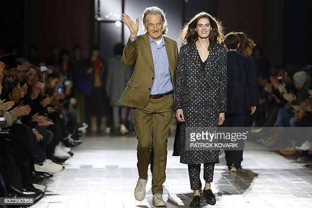 British designer Paul Smith acknowledges the public with models at the end of the Paul Smith show during the men's Fashion Week for the Fall/Winter...