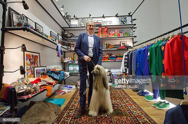 British designer Paul Smith poses for photographers with a dog during his presentation on the final day of the Autumn/Winter 2016 London Collections...
