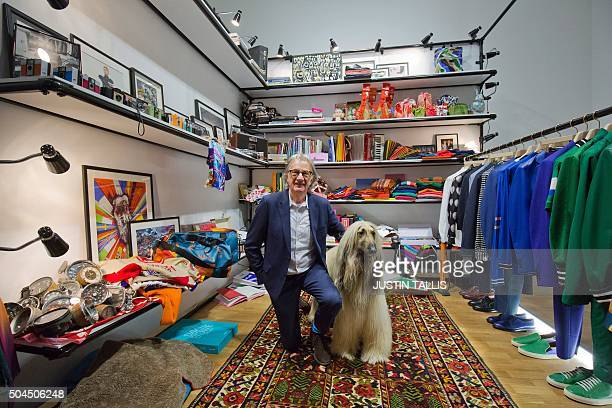 British designer Paul Smith poses for photographers with a dog, named Luca, during his presentation on the final day of the Autumn/Winter 2016 London...
