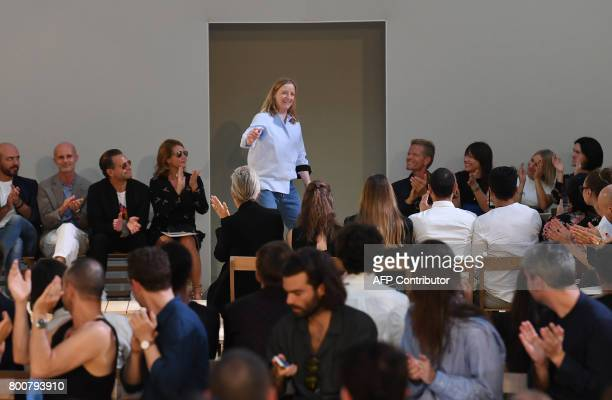 British designer Sarah Burton acknowledges the audience at the end of her show for Alexander McQueen fashion house during men's Fashion Week for the...