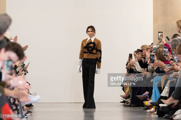 TOPSHOT British designer Victoria Beckham acknowledges the crowd during her 2019 Autumn / Winter collection catwalk show at London Fashion Week in...