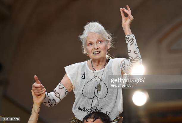 British designer Vivienne Westwood acknowledges the applause following a presentation of her latest designs at London Fashion Week Men's June 2017 in...