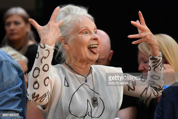 British designer Vivienne Westwood reacts as she talks discusses her catwalk show at before displaying her latest creations at London Fashion Week...