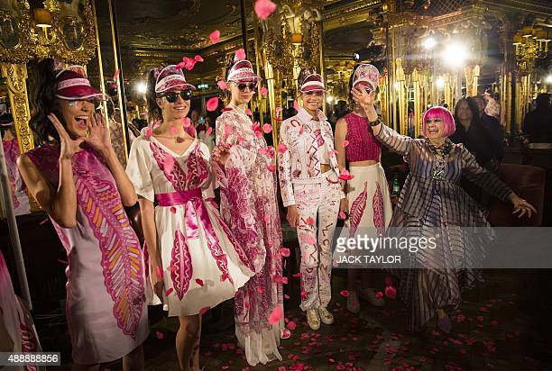 British designer Zandra Rhodes poses for pictures with models during the Spring / Summer 2016 London Fashion Week in London on September 18 2015 AFP...