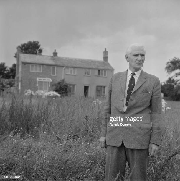 British detective Gerald McArthur standing outside the house at Leatherslade Farm near Brill in Buckinghamshire on the day of its discovery by police...