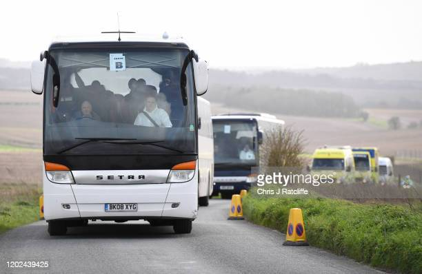 British Diamond Princess evacuees depart from Boscombe Down airfield following a repatriation flight from Tokyo on February 22 2020 in Amesbury...