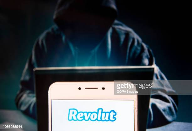 British digital banking includes a prepaid debit card currency exchange cryptocurrency exchange Revolut logo is seen on an Android mobile device with...
