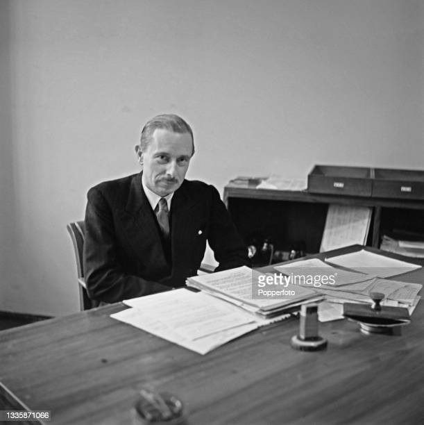 British diplomat Ivone Kirkpatrick , Controller of the European services at the British Broadcasting Corporation, seated at his desk in a BBC...