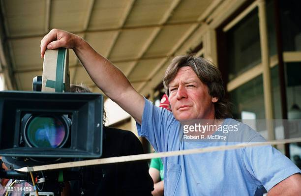British director Alan Parker leans on a camera Braxton Mississippi May 6 1988