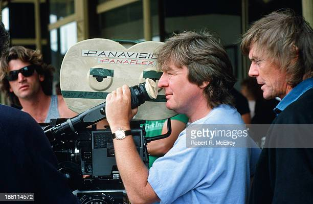 British director Alan Parker lines up a shot in a camera viewfinder on the set of his movie 'Mississippi Burning' Braxton Mississippi May 6 1988
