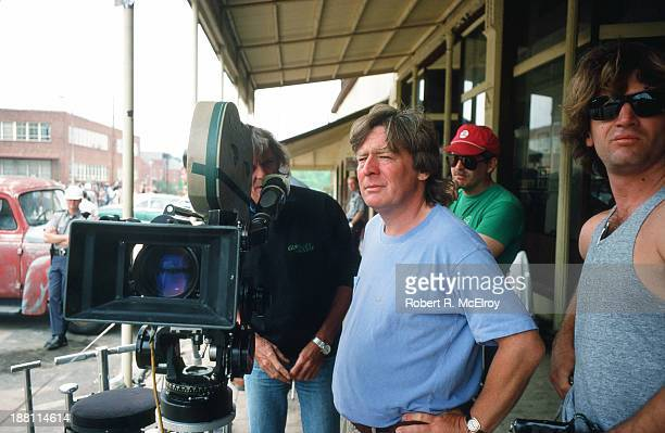 British director Alan Parker stands beside a camera on the set of his movie 'Mississippi Burning' Braxton Mississippi May 6 1988