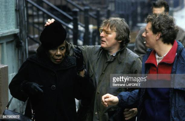 British director Alan Parker with actress on set of his movie Angel Heart in March 1987 in United States