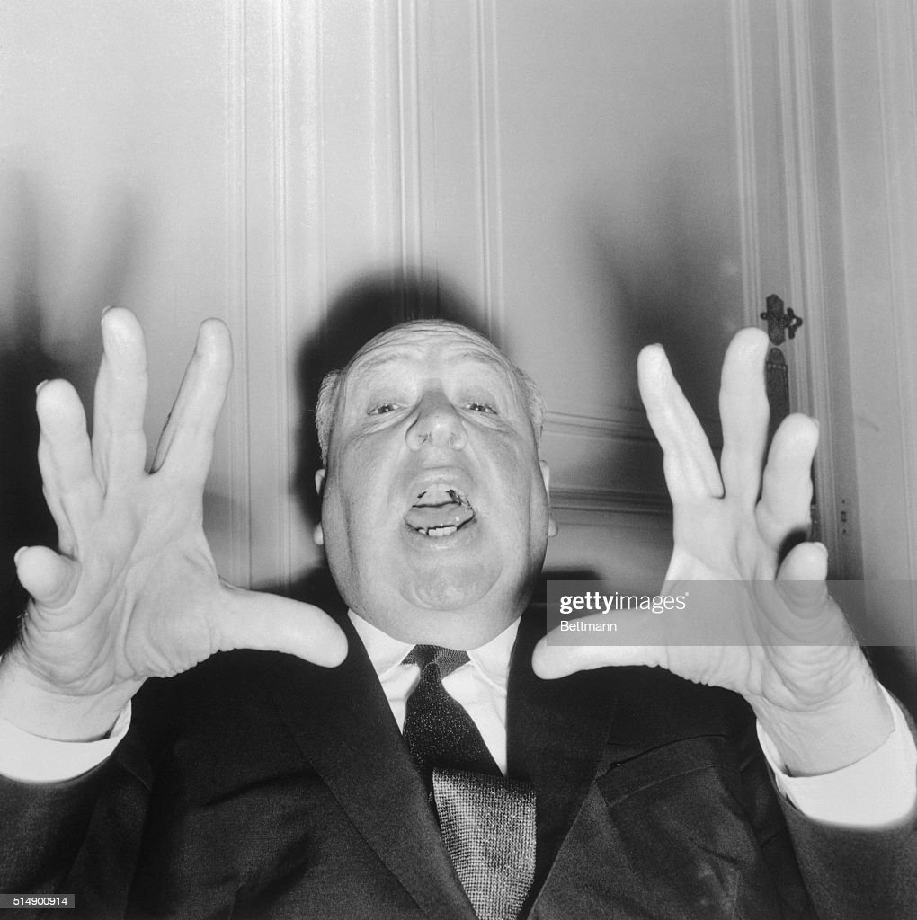 British director Alfred Hitchcock vamps for the camera as he appeared in Paris to present his new thriller, Psycho.