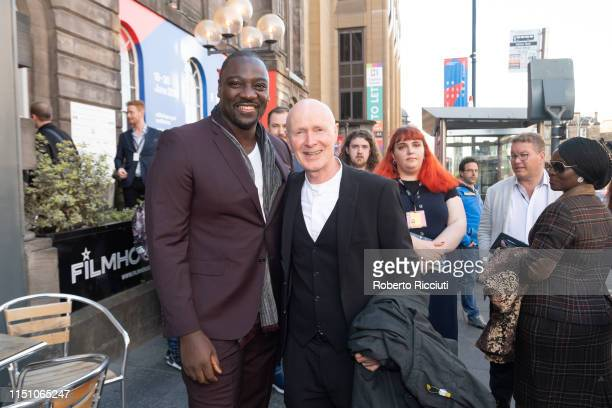 British director and actor Adewale AkinnuoyeAgbaje and Paul Laverty meet at a photocall for the UK Premiere of 'Farming' during the 73rd Edinburgh...