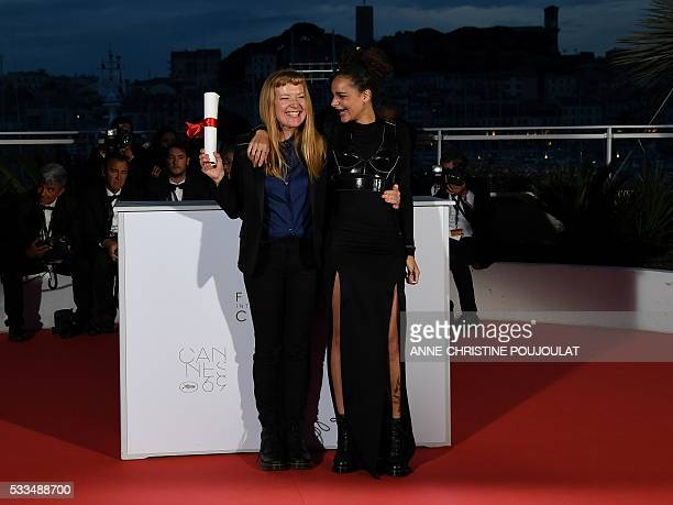 British director Andrea Arnold and US actress Sasha Lane pose after Arnold was awarded with the Jury Prize for the film American Honey on May 22 2016...