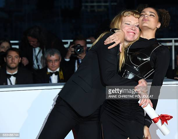 TOPSHOT British director Andrea Arnold and US actress Sasha Lane pose after Arnold was awarded with the Jury Prize for the film American Honey on May...
