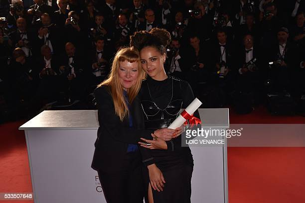 British director Andrea Arnold poses during a photocall with US actress Sasha Lane after she was awarded with the Jury Prize for the film 'American...