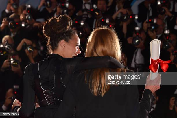 "British director Andrea Arnold poses during a photocall with US actress Sasha Lane after she was awarded with the Jury Prize for the film ""American..."