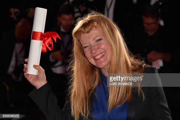 "British director Andrea Arnold poses with her trophy during a photocall after she was awarded with the Jury Prize for the film ""American Honey""at..."