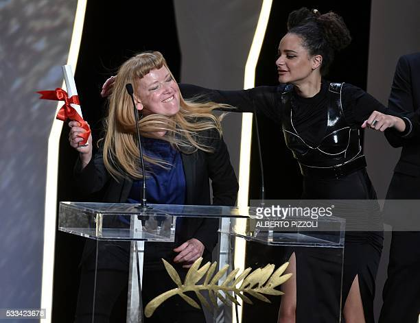 TOPSHOT British director Andrea Arnold reacts on stage next to US actress Sasha Lane after being awarded with the Jury Prize for the film 'American...