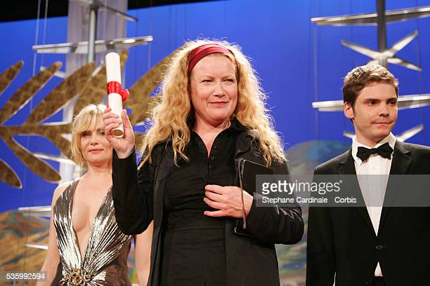 British director Andrea Arnold receives the Jury Prize for 'Red Road' from Emmanuelle Seigner and Daniel Bruhl at the closing ceremony of the 59th...