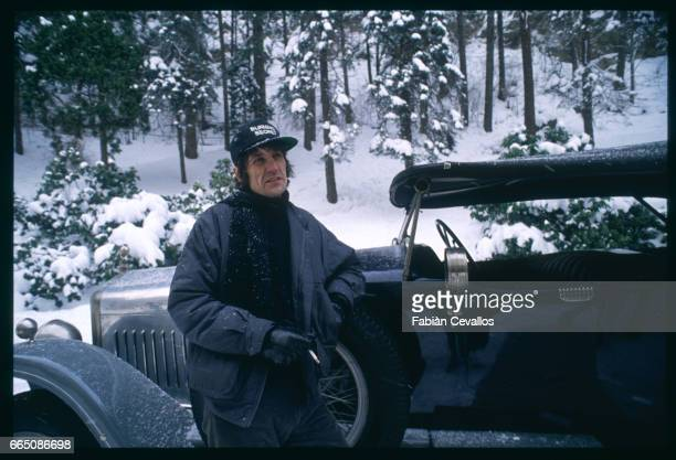 British director Andrew Birkin leans on a vintage automobile as he prepares a scene on the set of his 1988 movie Burning Secret or Brennendes...