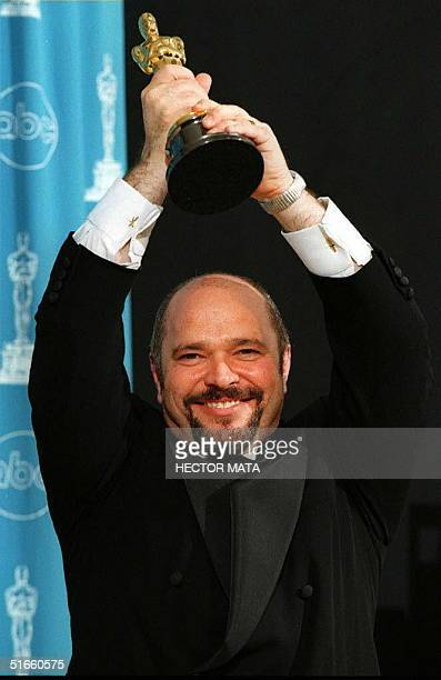 British director Anthony Minghella holds his Oscar for his work on the film 'The English Patient' during the 69th Annual Academy Awards 24 March in...