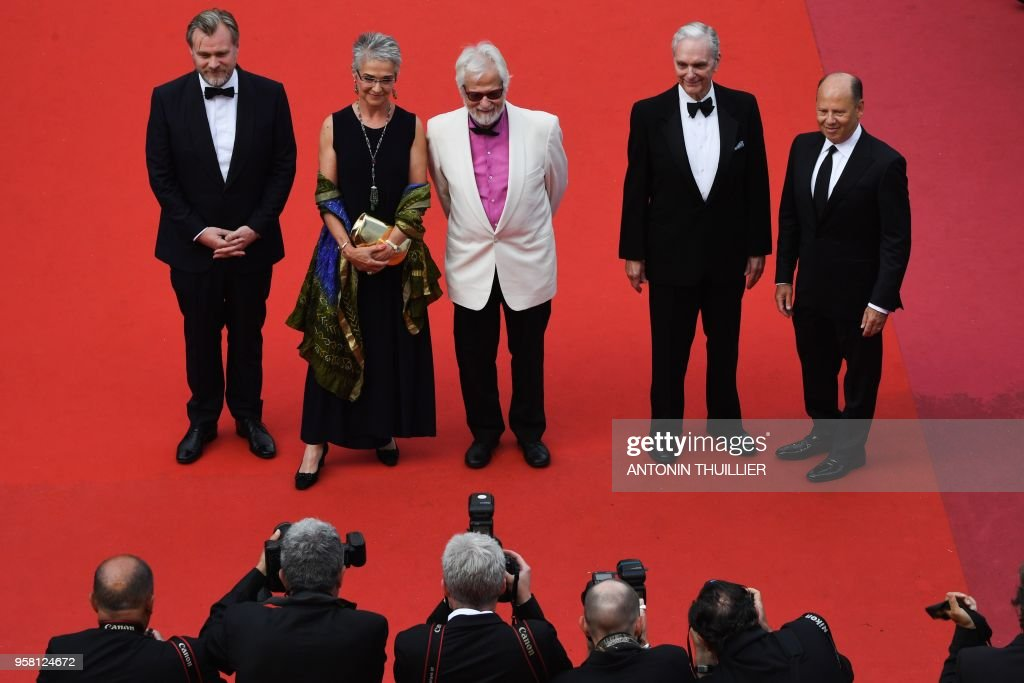 British director Christopher Nolan, Katharina Kubrick, daughter of British director Stanley Kubrick, German-US producer Jan Harlan, US actor Keir Dullea and a guest pose as they arrive on May 13, 2018 for the screening of a remastered version of the film '2001: A Space Odyssey' at the 71st edition of the Cannes Film Festival in Cannes, southern France.