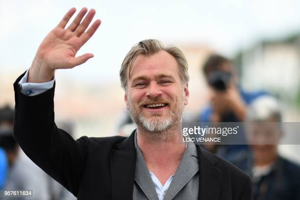 British director Christopher Nolan waves on May 12, 2018 during a photocall at the 71st edition of the Cannes Film Festival in Cannes, southern...