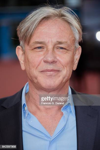 British director Damian Harris poses on the red carpet before the screening of the movie 'The Promise' during the 43rd Deauville American Film...
