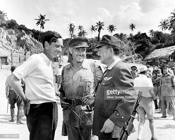 British director David Lean with Alec Guinness and Sessue Hayakawa on the set of 'The Bridge On The River Kwai', Sri Lanka, 1952.