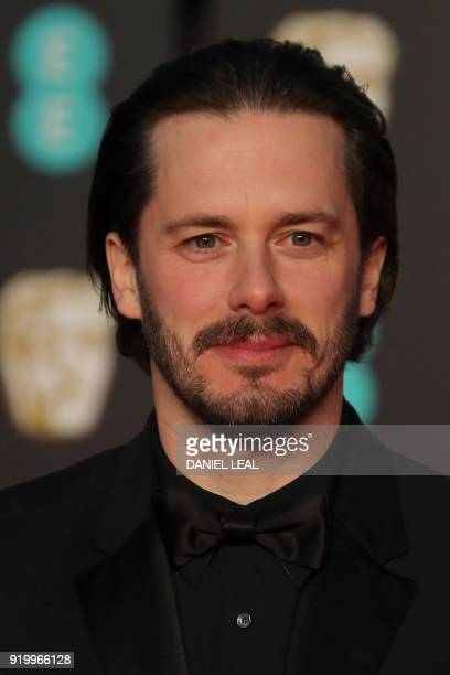 British director Edgar Howard Wright poses on the red carpet upon arrival at the BAFTA British Academy Film Awards at the Royal Albert Hall in London...