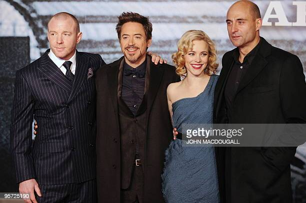 British director Guy Ritchie, US actor Robert Downey Jr, Canadian actress Rachel McAdams and British actor Mark Strong pose for photographers on the...