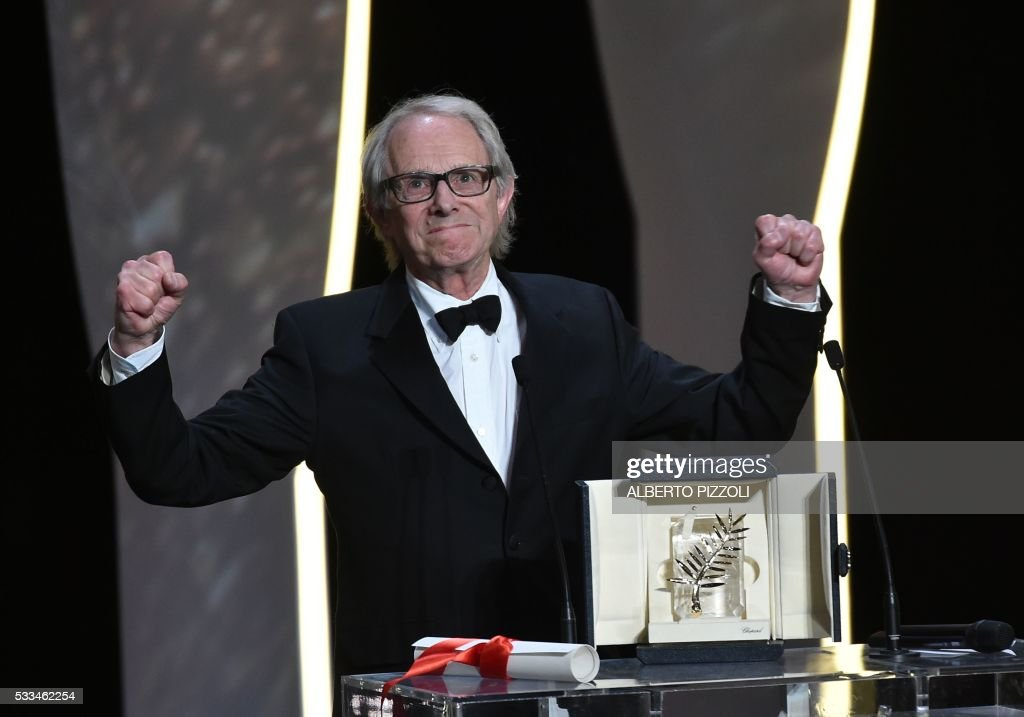 TOPSHOT - British director Ken Loach celebrates after being awarded with the Palme d'Or for the film 'I, Daniel Blake' during the closing ceremony of the 69th Cannes Film Festival in Cannes, southern France, on May 22, 2016. /