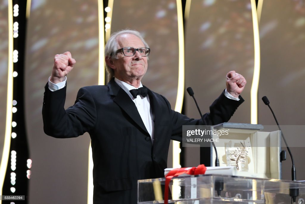 TOPSHOT - British director Ken Loach celebrates on stage after being awarded with the Palme d'Or for the film 'I, Daniel Blake' during the closing ceremony of the 69th Cannes Film Festival in Cannes, southern France, on May 22, 2016. / AFP PHOTO / Valery HACHE