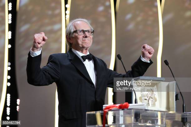 TOPSHOT British director Ken Loach celebrates on stage after being awarded with the Palme d'Or for the film 'I Daniel Blake' during the closing...