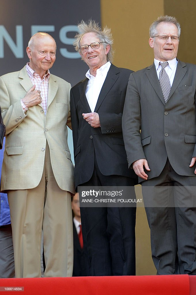 British director Ken Loach (C) speaks with Cannes Film Festival President Gilles Jacob (L) and director Thierry Fremaux as he arrives for the screening of 'Route Irish' presented in competition at the 63rd Cannes Film Festival on May 20, 2010 in Cannes.