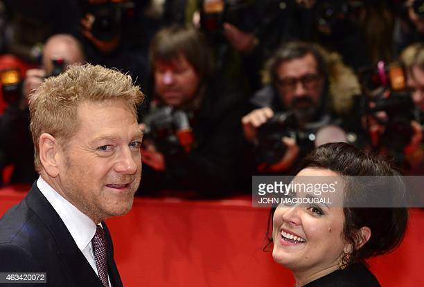 British director Kenneth Branagh and wife Lindsay Brunnock pose for photographers on the red carpet as they arrive for the screening of the film...
